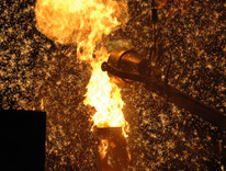 Flames and sparks flew as molten iron poured into sculpture castings on March 15