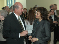 Chancellor Jerry Wartgow chats with a colleague at his retirement reception