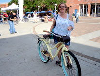 Bike to Work Day participant Kristen Cochran enjoys the breakfast station at Auraria Commons
