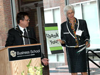 CU Denver Business School Dean Sueann Ambron receives thanks from Associate Professor Manuel Serapio