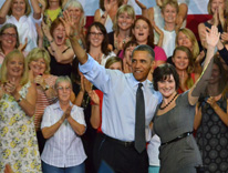 President Obama standing with Sandra Fluke
