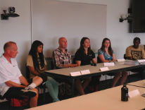 Student panel talking to new faculty