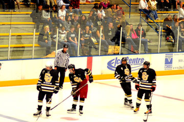 The CU Denver hockey team plays in front of a section of CU Denver supporters at the season-opening game.