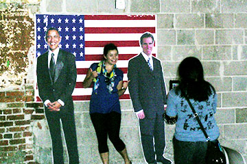 Students take pictures with Obama and Romney