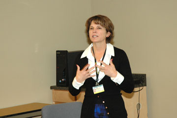 Cathy Bodine, executive director of Assistive Technology Partners, delivers a lunch-and-learn lesson at ATP