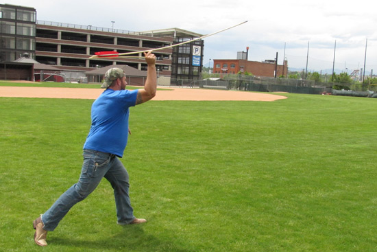 Using an atlatl to throw a dart in Julien Riel-Salvatore's Maymester course. Photo by Patrick Smythe