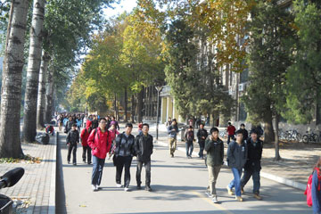 Students rush to their next class at International College Beijing