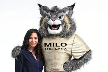 Student Juliana Valera stands with Milo the Lynx, the mascot she named