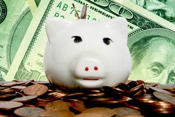 Piggy bank, pennies and Benjamin Franklin