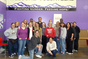 Human Resources team poses for a picture at Food Bank of the Rockies after volunteering at the warehouse