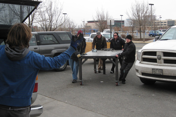 Students pitch in to move their workstations across campus