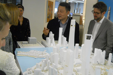 Jun Xia shows some model building in his Shanghai office.