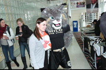 CU Denver student Cait Baxter poses with Milo the Lynx on April 17 in North Classroom