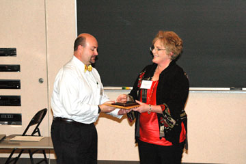 Casey Allen of CU Denver receives the faculty mentor of the year award from Mary Coussons-Read