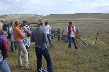 Professor Kat Vlahos (red vest) explains aspects of the Buffalo Peaks ranch to CU Denver students