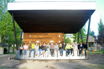 Students from the CU Denver design-build program sit on the new outdoor stage they built in Ridgway