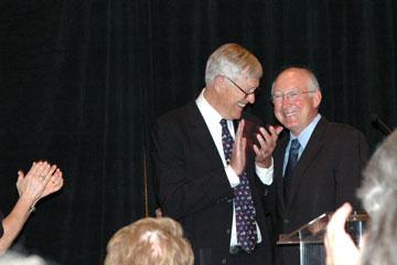 Former U.S. Sen. Tim Wirth, left, awards Ken Salazar, former U.S. Interior Secretary, with a Wirth Sustainability Award June 10