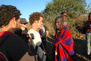 CU Denver students Quinn Williams and Thornton Giese meet with Simon Mataro, a Masai, in Tanzania