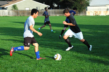 Players on CU Denvers new mens soccer team go through drills at a recent practice