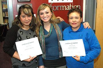Graduates of a housekeeper tutorial program display certificates at CU Denver