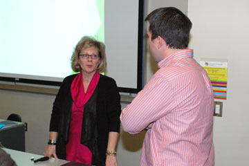 Sue Wyman talks with a student about job search tips after a Job Search Boot Camp at CU Denver