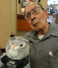 WWII army veteran CU Denver graduate Paul Mares with Milo the Lynx