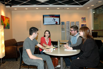 CU Career Center staff meet around a table in the newly renovated center entryway