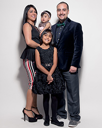 "Mario ""DJ Chonz"" Rodriguez and family"