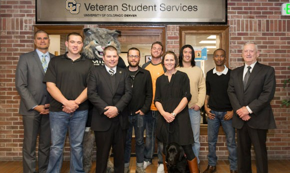 Former U.S. Marine Corps Gen. James Mattis stands with the staff at Veteran Student Services and Milo the Lynx.