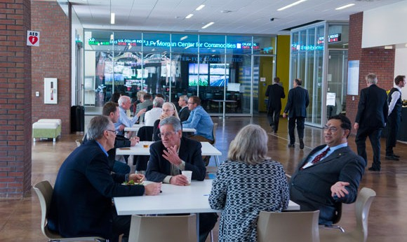 Attendees chat at conference of Research Council on Commodities at CU Denver Business School