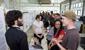 CU Denver Learning Assistants present their research at a poster presentation.