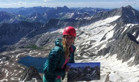 Lisa Martin paints from the top of a 14er
