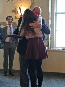 Allie Kriese hugs Jerry Wartgow