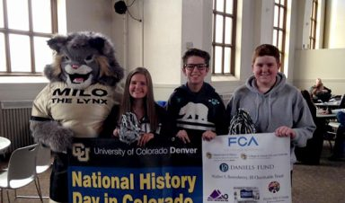 Milo celebrates National History Day in Colorado with visiting students.