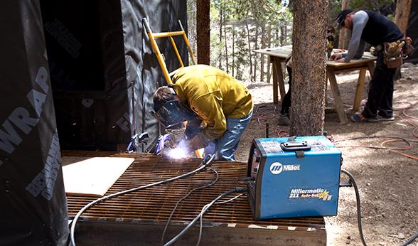 Welding a cabin entry in Leadville