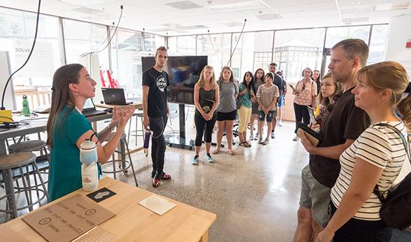 Assistant Professor Kate Goodman greets the group inside Inworks