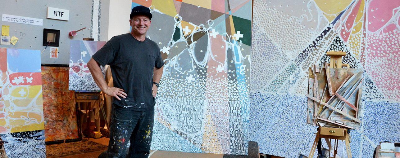 Ken Walker with his art