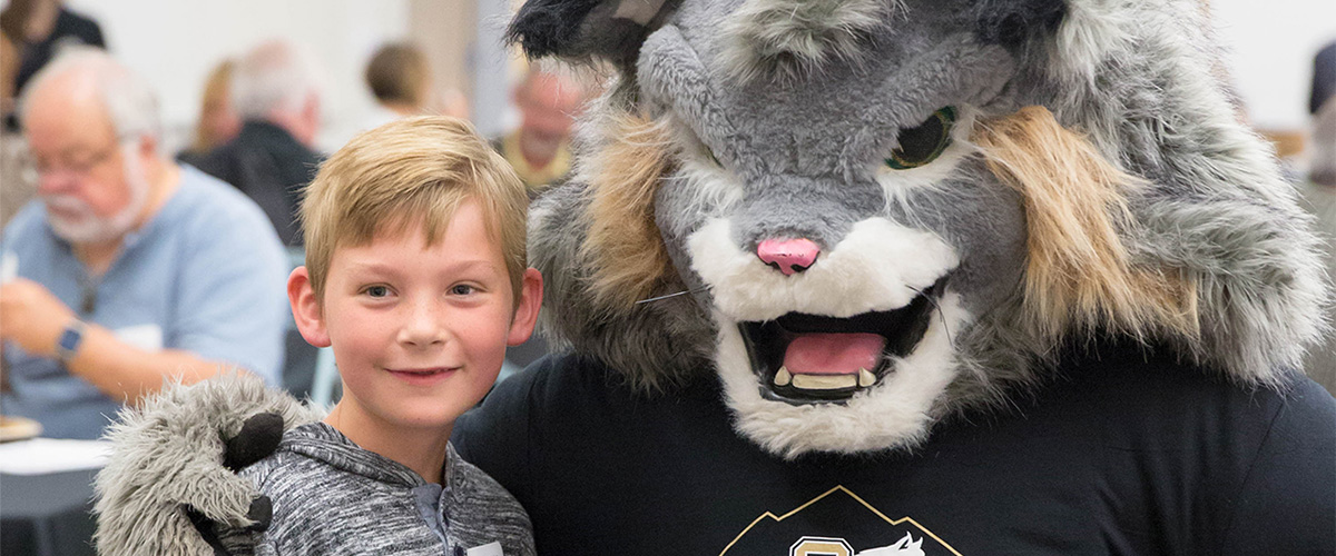 Milo the Lynx and a young member of the CU Denver family