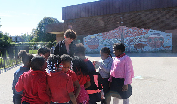 CU Denver student Makena Roesch with Edward T. Steele Elementary School students at recess