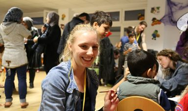 Student volunteer at Halloween party