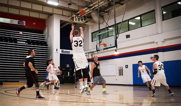 Men's Club Basketball player takes a jump shot