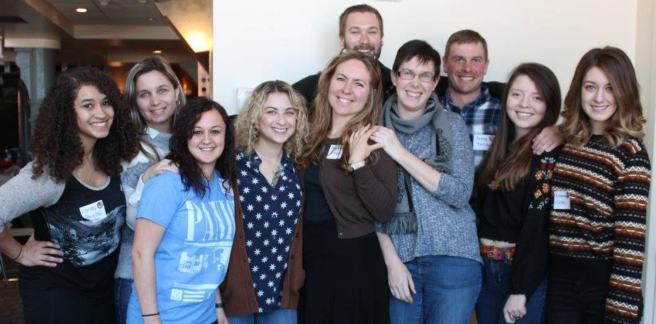 Reisher Scholars in the 2014 cohort celebrate their impending graduation