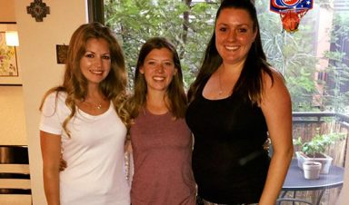 Sabrina Walker, center, maintains her friendships with roommates from her CU Denver days.