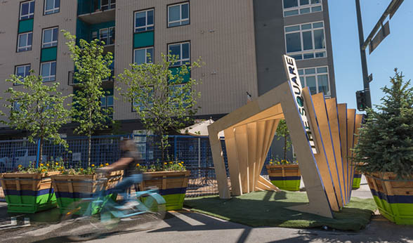 Bicyclist enters Denver pop-up park