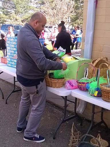 CU Denver student Jose Silva helps at an Easter event