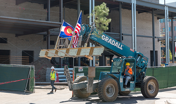 Forklifting final beam to CU Denver Student Wellness Center