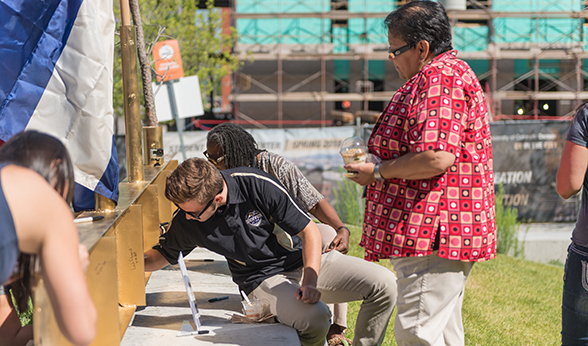 Students sign topping-off beam for CU Denver Student Wellness Center