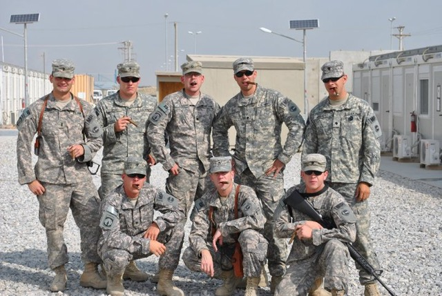 Gherardini, left, with his Colorado Army National Guard unit