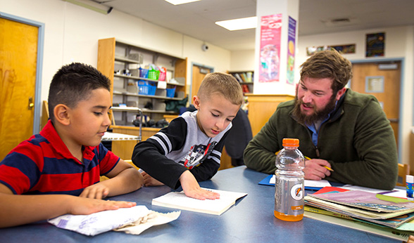 CU Denver student Brian Andreatta and reading partners