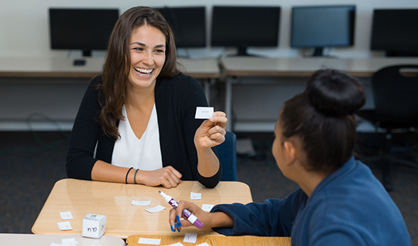 Lucia Cordovano with student at desk